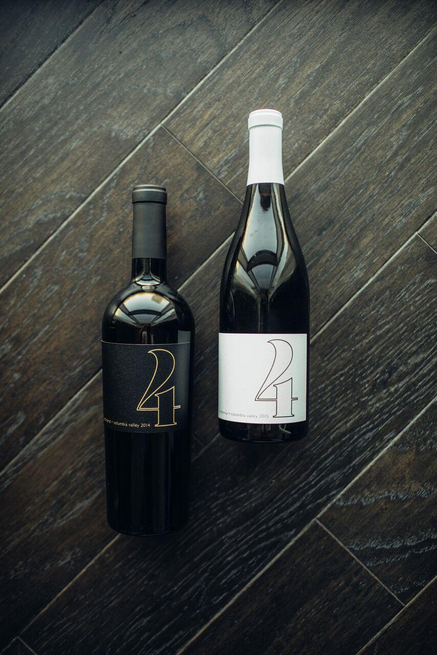 4 Cellars wine bottles laid flat on wood floor