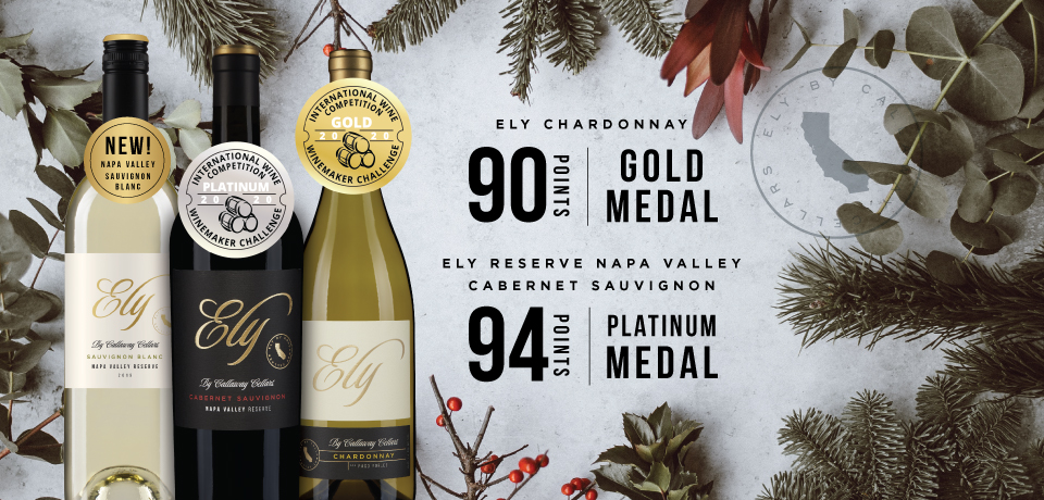 Bottles of Ely by Callaway Cellars against pine tree branches with 90 and 94 point scores.
